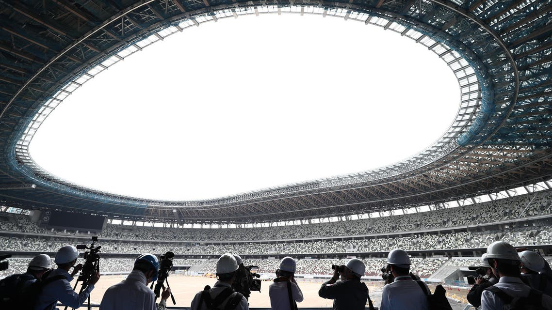 Members of the media visit the new National Stadium under construction, a venue for the upcoming Tokyo 2020 Olympic Games, in Tokyo on July 3, 2019. (AFP)