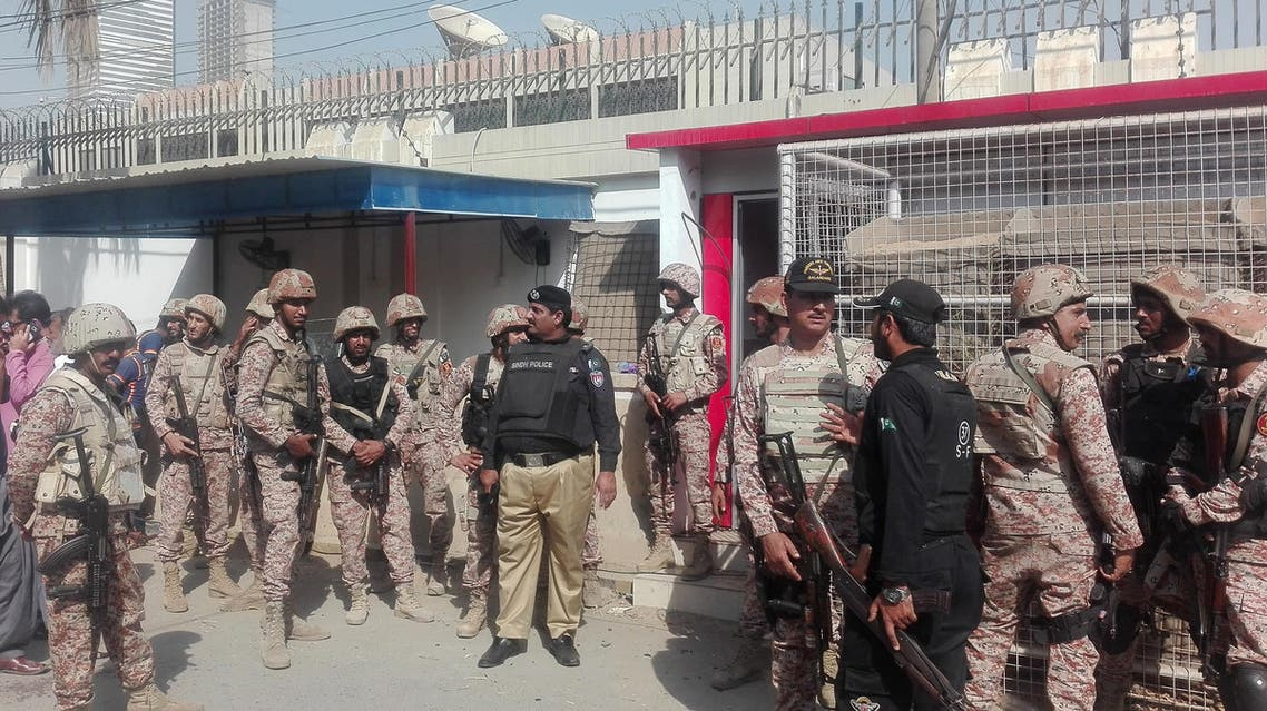Pakistani security personnel stand outside the Chinese consulate after one of the attacks carried out by the group in Karachi. (File photo: AFP)