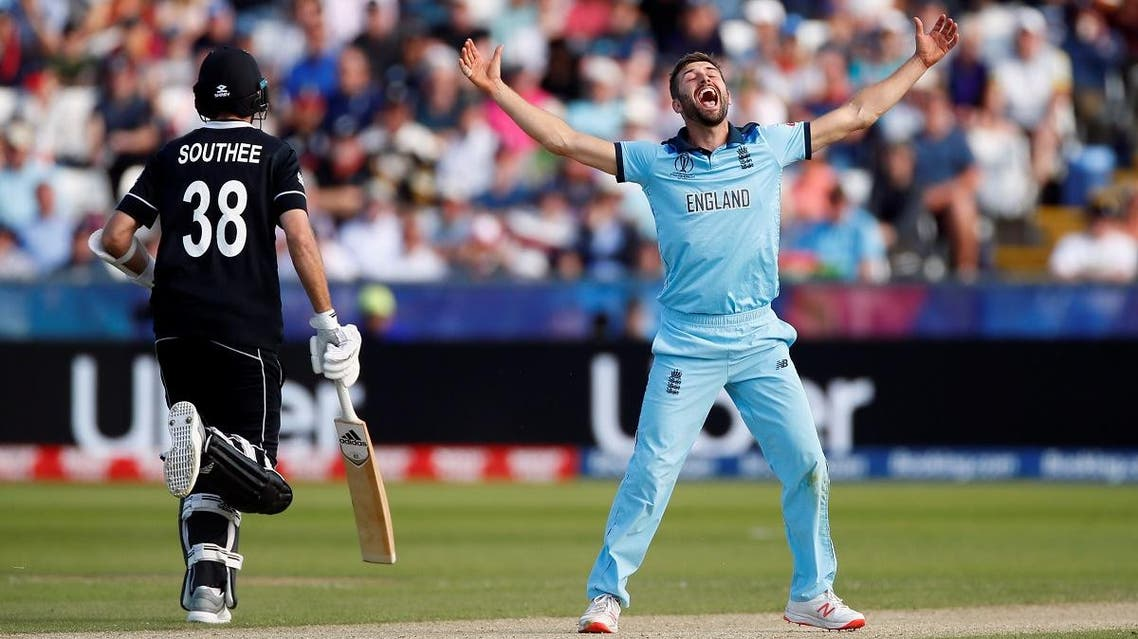 England's Mark Wood celebrates the dismissal of New Zealand's Mitchell Santner. (Reuters)