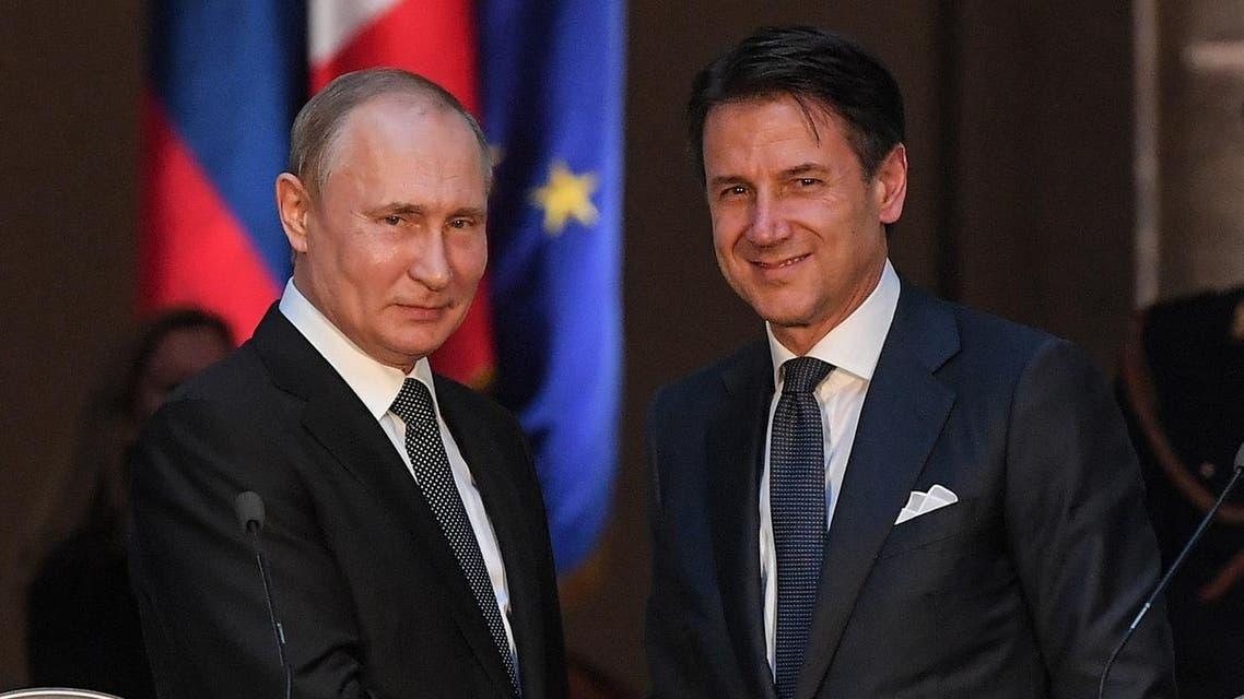 Italian Prime Minister Giuseppe Conte (R) and Russian President Vladimir Putin shake hands after holding a joint press conference following their meeting at palazzo Chigi in Rome on July 4, 2019 AFP