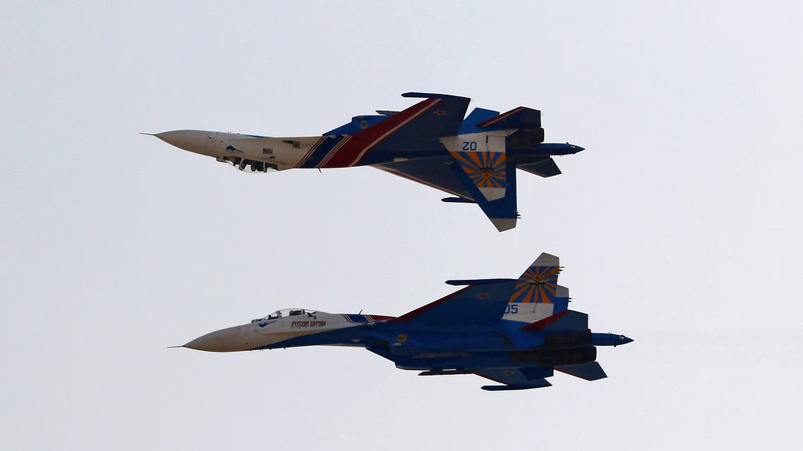 Two Sukhoi Su-27 jets from the Russian Knights aerobatic team fly during an airshow in Iran's southern resort island of Kish on November 16, 2016.