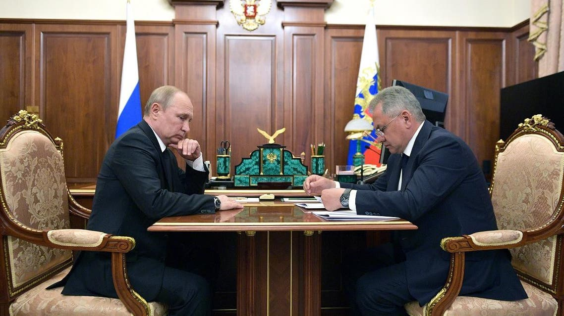 President Vladimir Putin (L) meets with Russian Defence Minister Sergei Shoigu in Moscow on July 2, 2019. Fourteen Russian seamen have died in a fire on a deep-water research submersible, Russia's defence ministry said on July 2, 2019. (AFP)