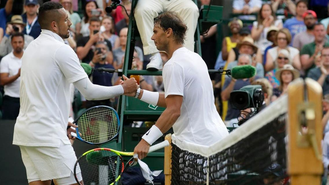 Rafael Nadal (right), greets Nick Kyrgios at the net after beating him in a Men's singles match during day four of the Wimbledon Tennis Championships in London, on July 4, 2019. (AP)