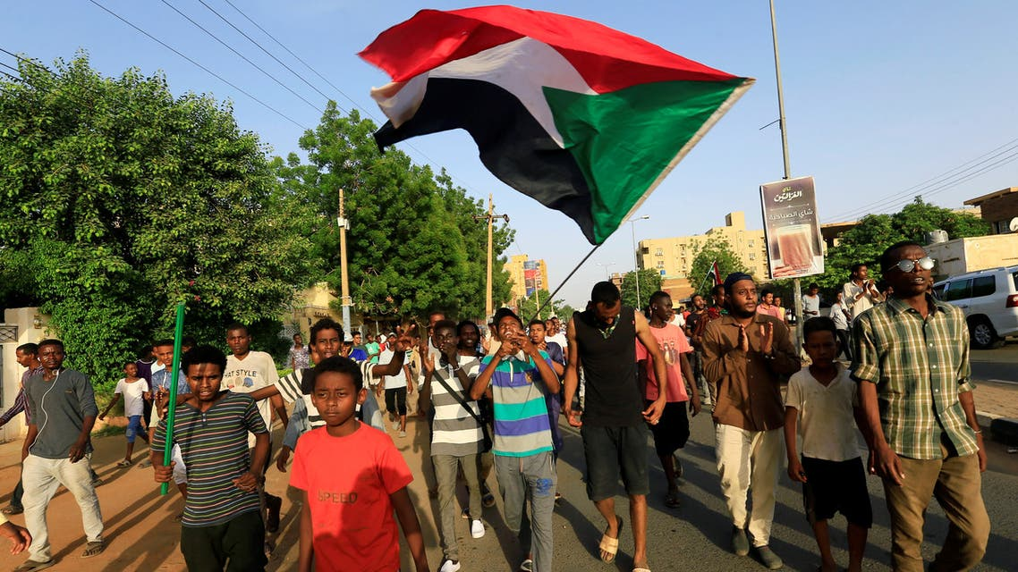 Sudanese people celebrate and wave their national flag, after Sudan's ruling military council and a coalition of opposition and protest groups reached an agreement to share power during a transition period leading to elections, along the street of Khartoum, Sudan, July 5, 2019. REUTERS/Mohamed Nureldin Abdallah