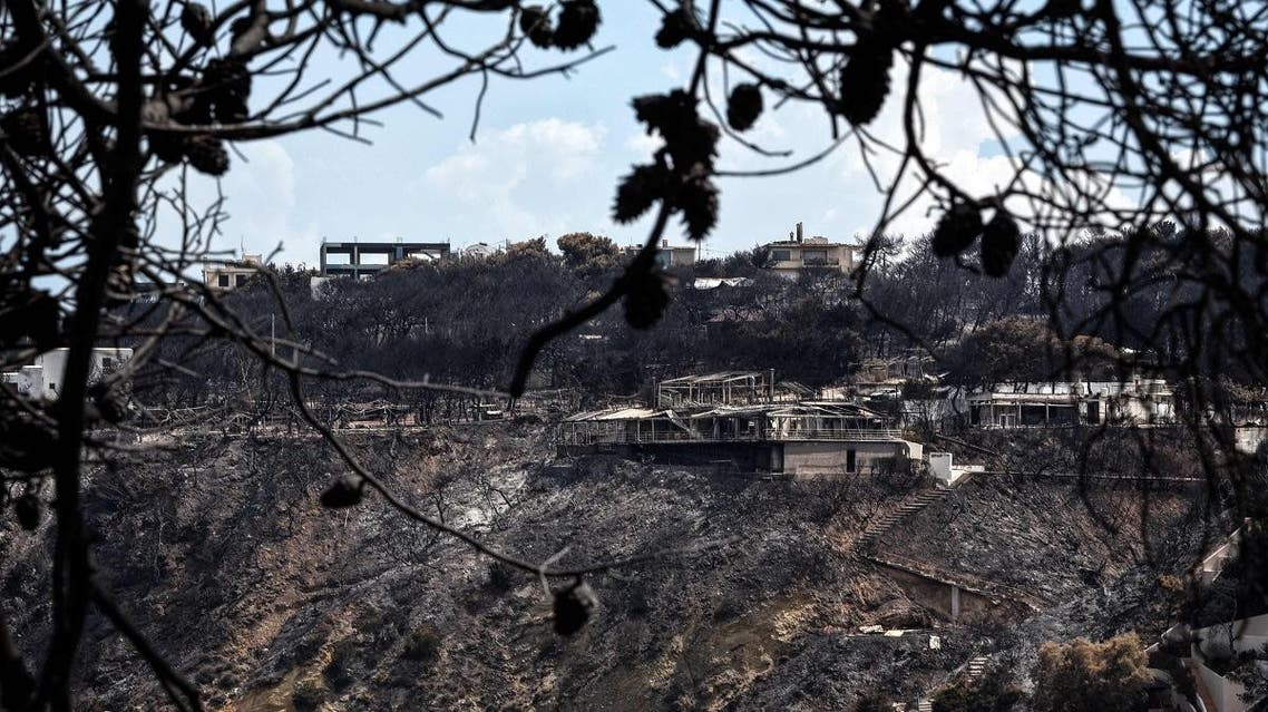 Burned properties on a cliff of the seaside resort of Mati, eastern Attica region, are pictured on July 27, 2018. (AFP)