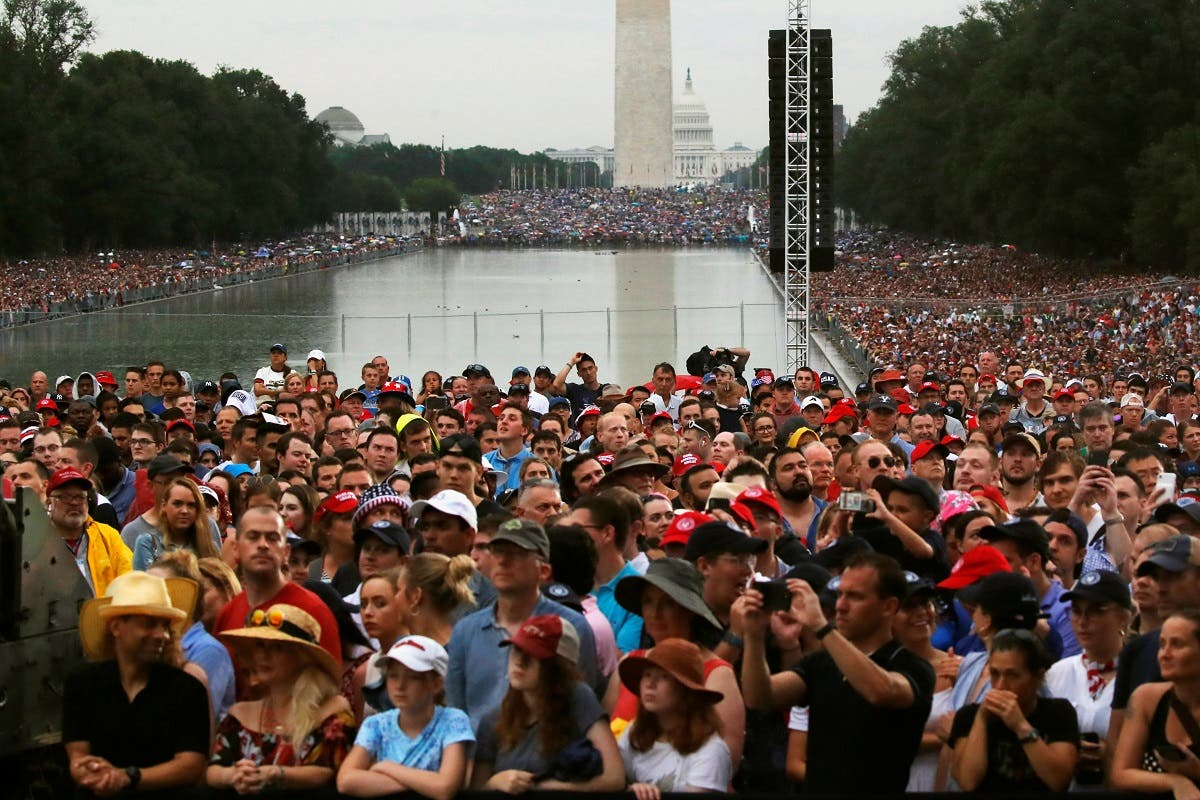 """Attendees listen as US President Donald Trump addresses the """"Salute to America"""" event during Fourth of July Independence Day celebrations at the Lincoln Memorial in Washington, D.C., US, on July 4, 2019. (Reuters)"""