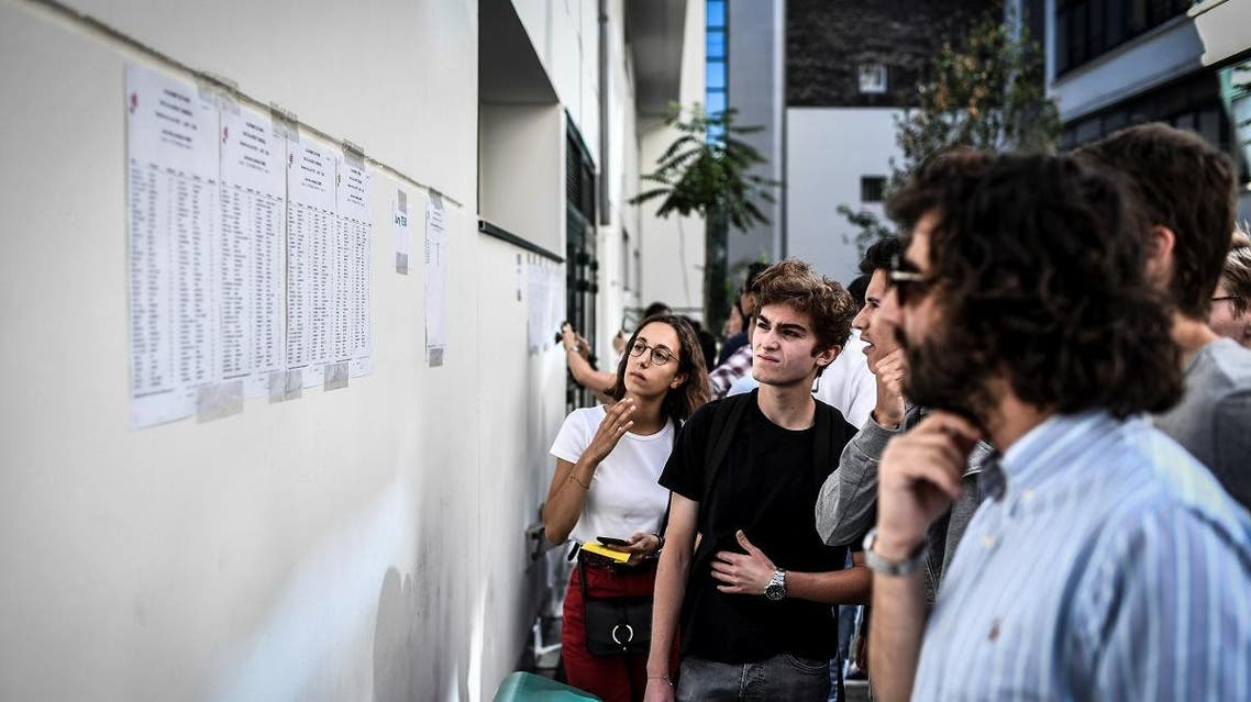 Students check the results of the baccalaureat exam (high school graduation exam) at the Fresnel high school in Paris. (AFP)