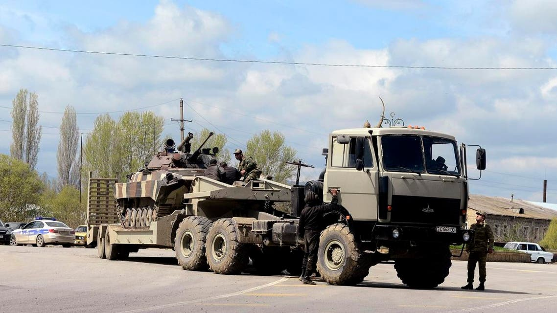 An Azeri military armoured personnel carrier (APC) is seen on the platform of a truck in the town of Terter, Azerbaijan. (File photo: AFP)