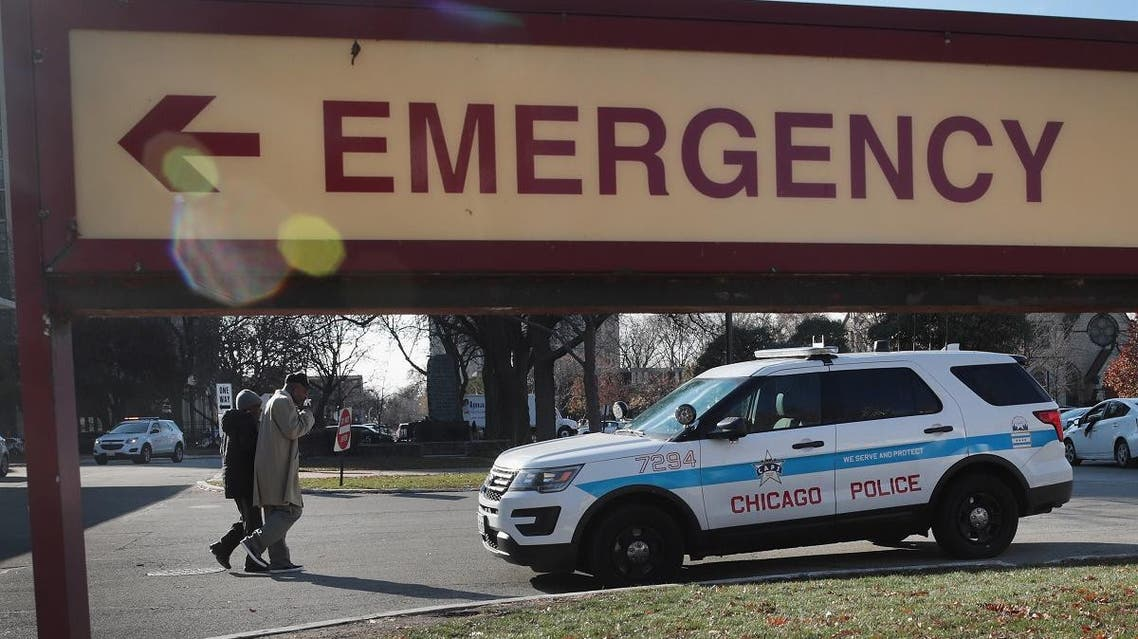 In this file photo taken on November 19, 2018 A police vehicle sits outside of Mercy Hospital where four people were shot and killed yesterday in Chicago, Illinois. (AFP)