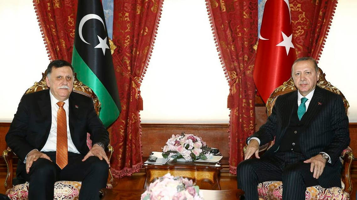 Turkish President Recep Tayyip Erdogan, right, and Fayez al-Sarraj, the Chairman of the Libyan Presidential Council, pose for a photo during a meeting and shortly before departing for a five-day African tour, in Istanbul, Monday, Feb. 26, 2018. (Kayhan Ozer/Pool Photo via AP)