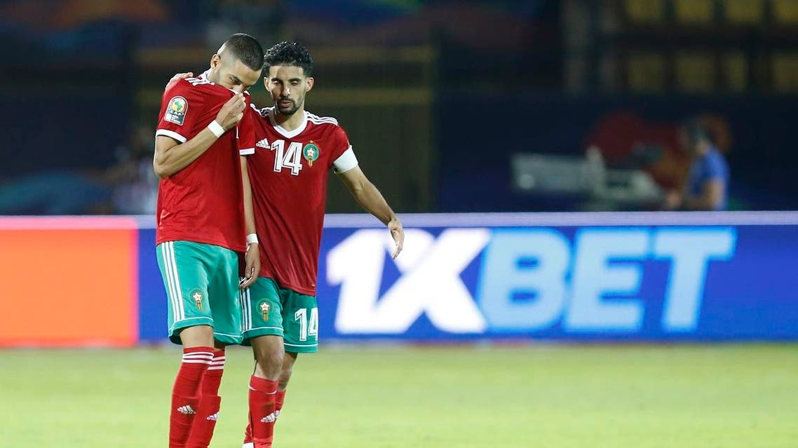 Morocco's Hakim Ziyach. left, and M'brak Boussoufa leave pitch dejected after the African Cup of Nations round of 16 soccer match between Morocco and Benin in Al Salam stadium in Cairo, Egypt, Friday, July 5, 2019. (AP)