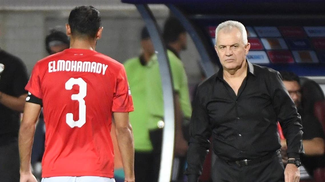 Egypt's coach Javier Aguirre (R) speaks with Egypt's defender Ahmed Elmohamady during the 2019 Africa Cup of Nations (CAN) Round of 16 football match between Egypt and South Africa at the Cairo International Stadium in the Egyptian Capital on July 6, 2019. (AFP)