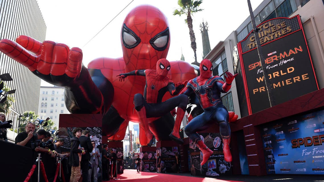 """Two Spider-Man characters jump in front of a Spider-Man float at the world premiere of """"Spider-Man: Far From Home"""" on Wednesday, June 26, 2019, at the TCL Chinese Theatre in Los Angeles. (AP)"""