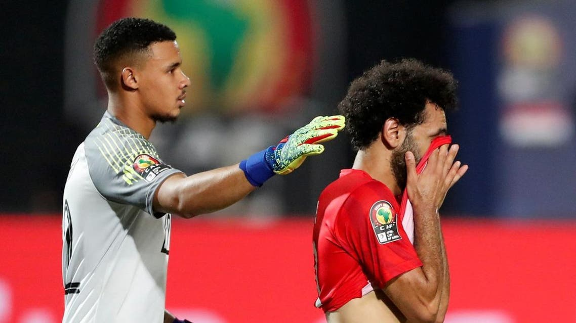 Egypt's Mohamed Salah and team mates look dejected after the match. (Reuters)