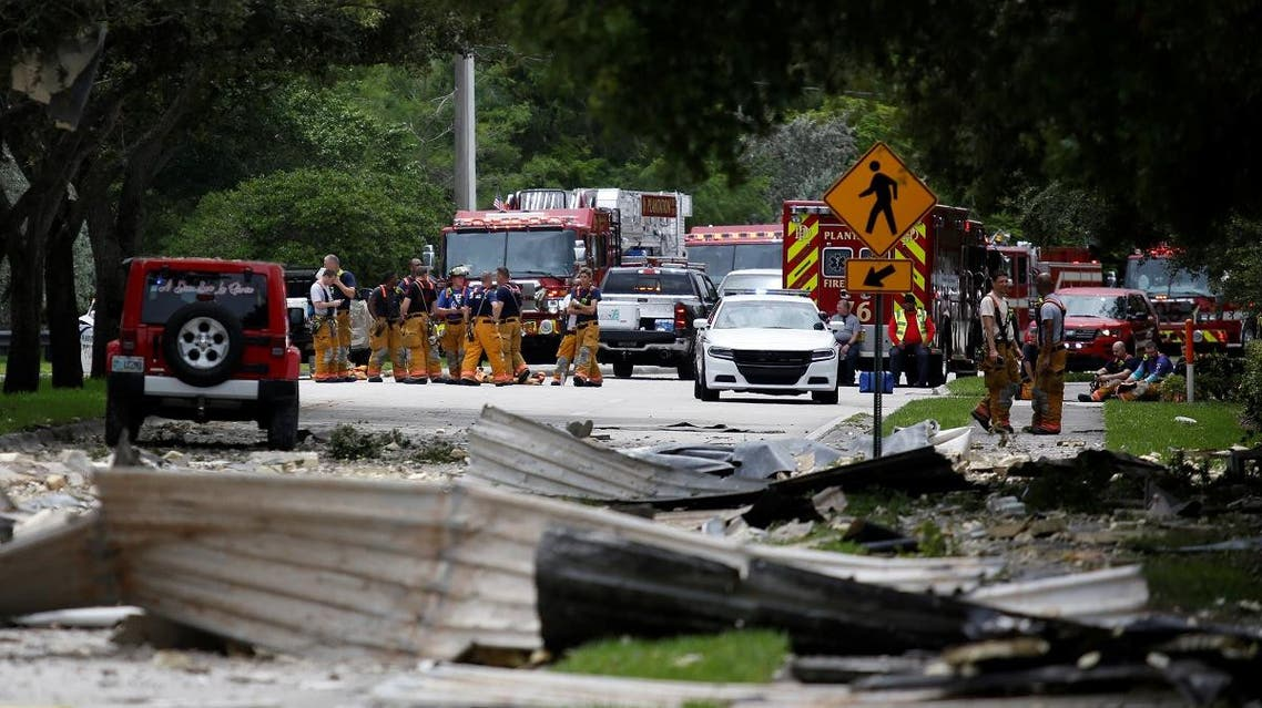 Rescue sources are seen in an affected area after an explosion at The Fountains shopping center in Plantation. (Reuters)