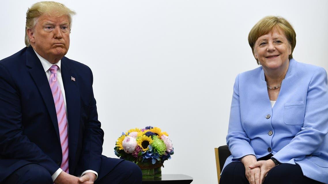 Trump and Merkel (AFP)