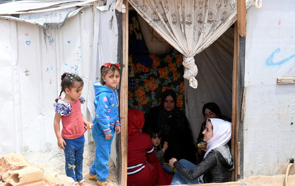 Syrian refugee women sit together in a tent at the Lebanese border town of Arsal, Lebanon June 9, 2019. (File photo: Reuters)