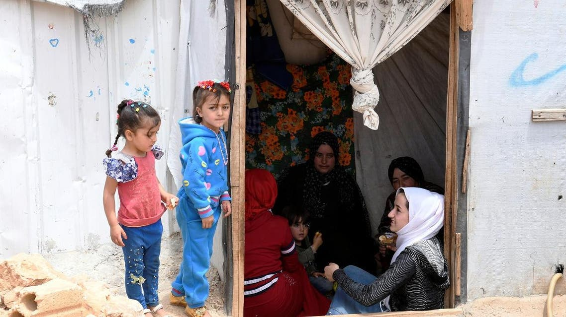 Syrian refugee women sit together in a tent at the Lebanese border town of Arsal, Lebanon June 9, 2019. (Reuters)