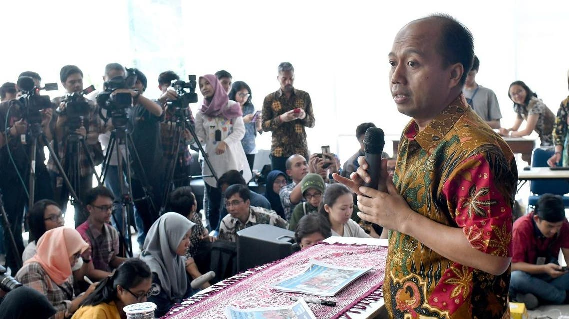 This photo taken on October 2, 2018 shows Indonesia's disaster agency spokesman Sutopo Purwo Nugroho (R) addressing the media during a press conference in Jakarta on the latest updates following the powerful earthquake and tsunami. (AFP)