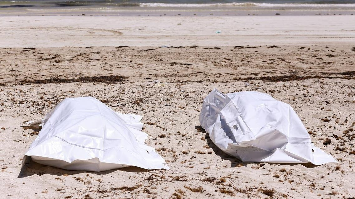 This picture taken on July 6, 2019 on the beach of Aghir in Tunisia's southern island of Djerba shows recovered bodies from a boat carrying 86 migrants that capsized off the Tunisian coast while crossing the Mediterranean from Libya to Italy. The latest tragedy came to light the same week as 44 migrants were killed in an air strike on their detention centre in a suburb of the Libyan capital. (AFP)