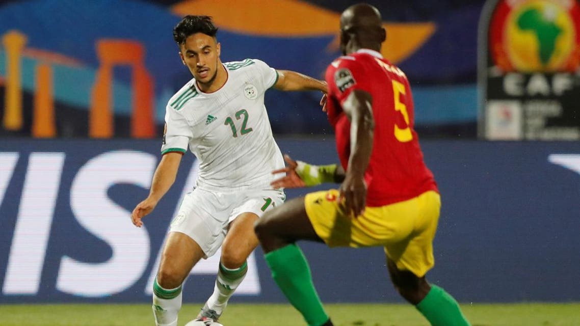 Algeria's Adam Ounas in action with Guinea's Ernest Seka  in the Africa Cup of Nations 2019 Round of 16 on July 7, 2019. (Reuters)