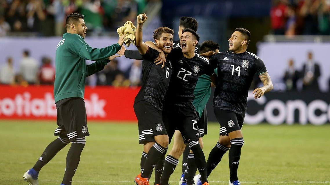 Jonathan dos Santos #6, Uriel Antuna #22, and Alexis Vega #14 of the Mexico celebrate after beating the United States 1-0 in the 2019 CONCACAF Gold Cup Final at Soldier Field on July 07, 2019 in Chicago. (AFP)