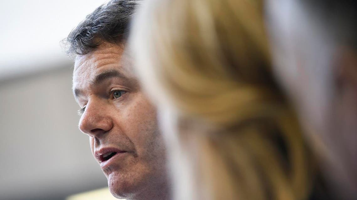 Ireland's Minister for Finance and Public Expenditure and Reform Paschal Donohoe answers journalists during Eurogroup meeting at the EU headquarters in Luxembourg on June 13, 2019