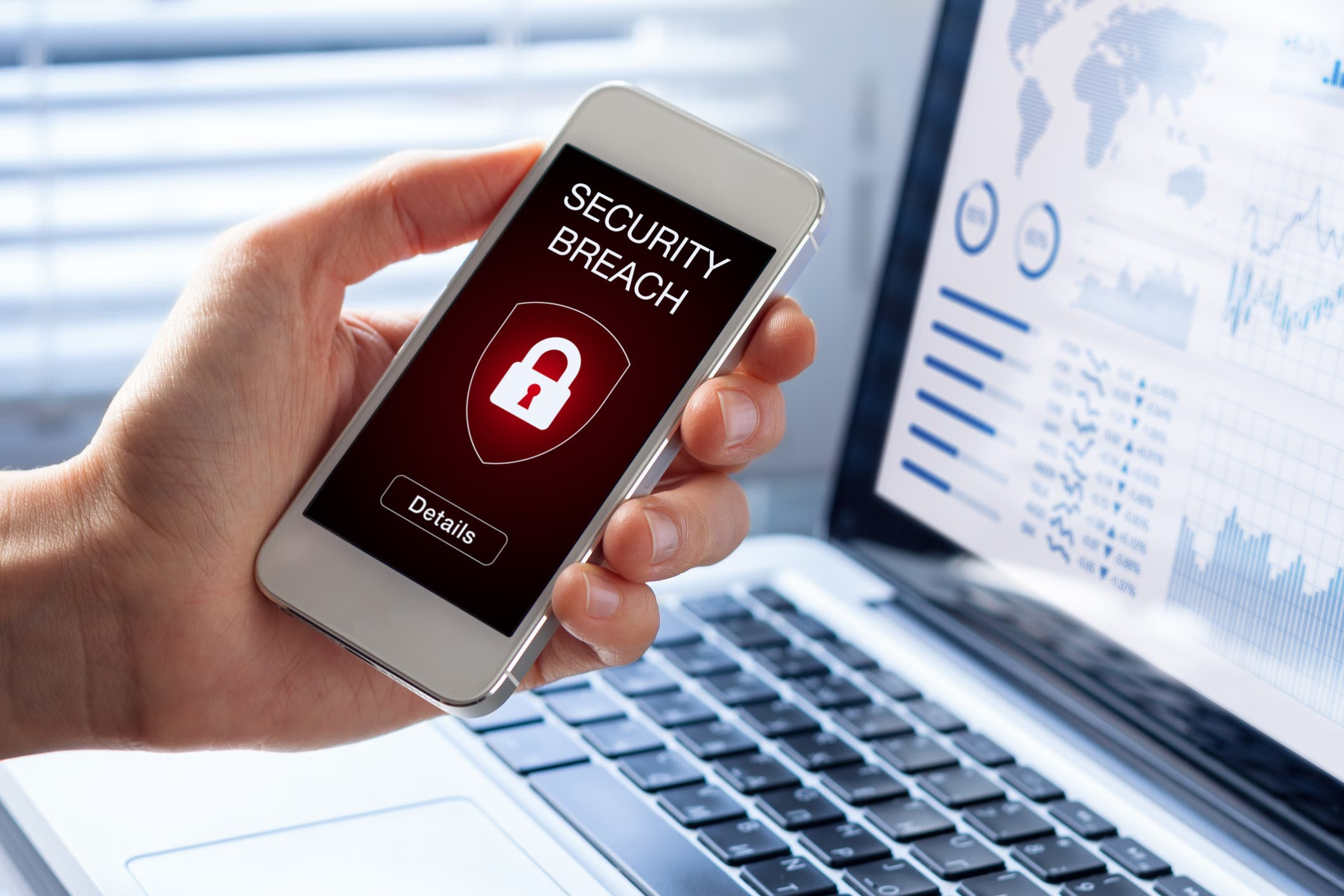 Security breach, smartphone screen, infected by internet virus, cyberattack hacking - Stock image