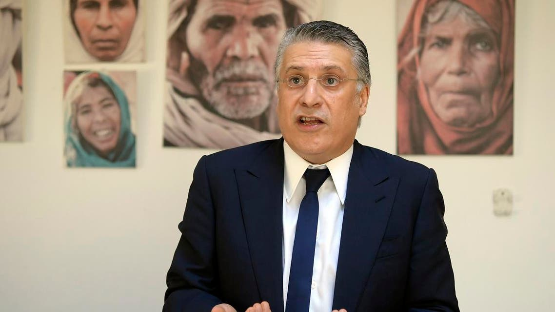 Tunisian presidential candidate Nabil Karoui speaks during an interview with AFP at his office in Tunis on June 18, 2019. (AFP)