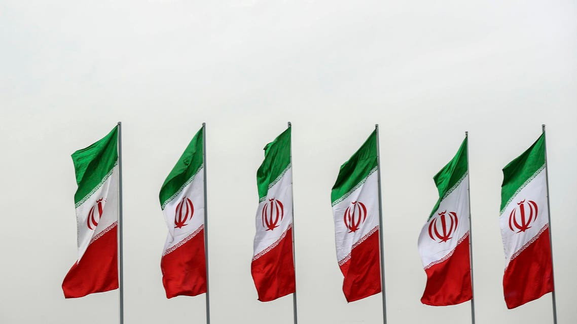 Iran flags - Iranian Presidency Office via AP