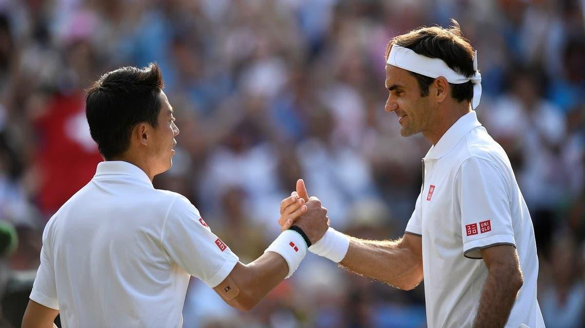 Roger Federer with Japan's Kei Nishikori after winning their quarter final match at Wimbledon on July 10, 2019. (Reuters)