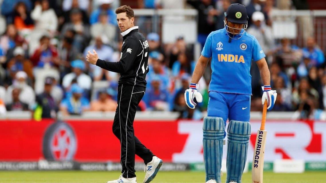 New Zealand's Mitchell Santner celebrates taking the wicket of India's Hardik Pandya. (Reuters)