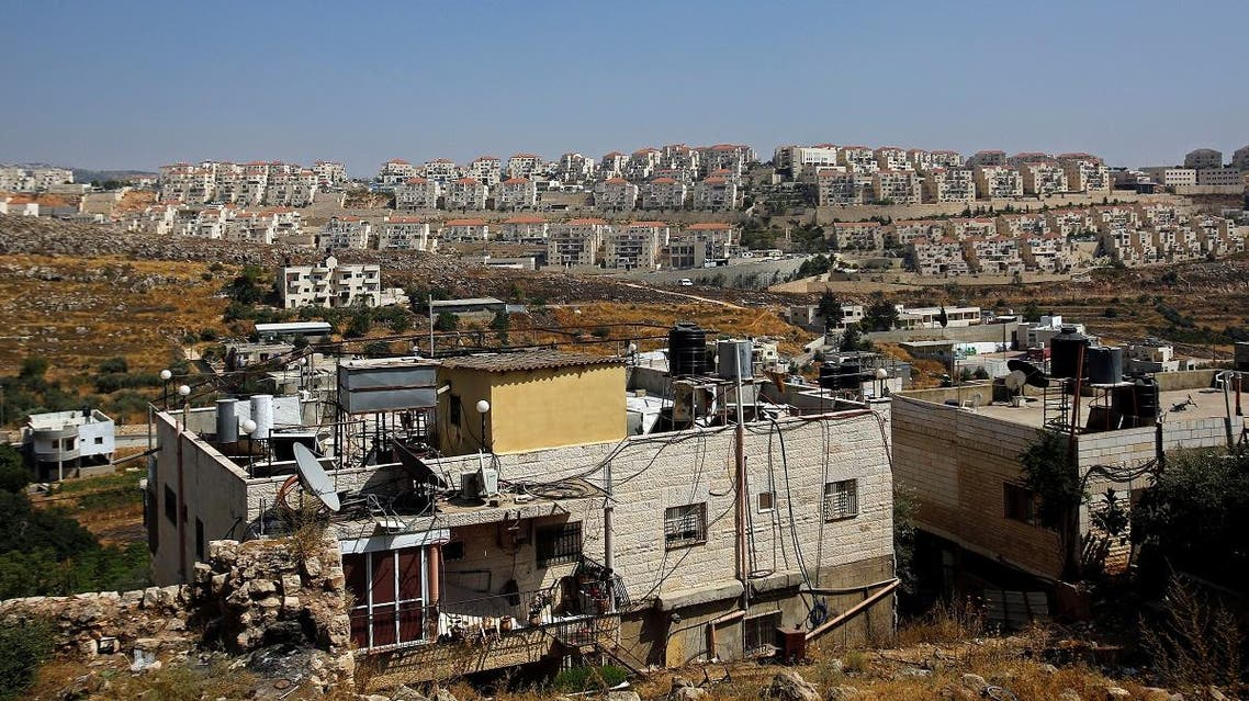 A view shows Palestinian houses in the village of Wadi Fukin as the Jewish settlement of Beitar Illit is seen in the background, in the Israeli-occupied West Bank. (Reuters)