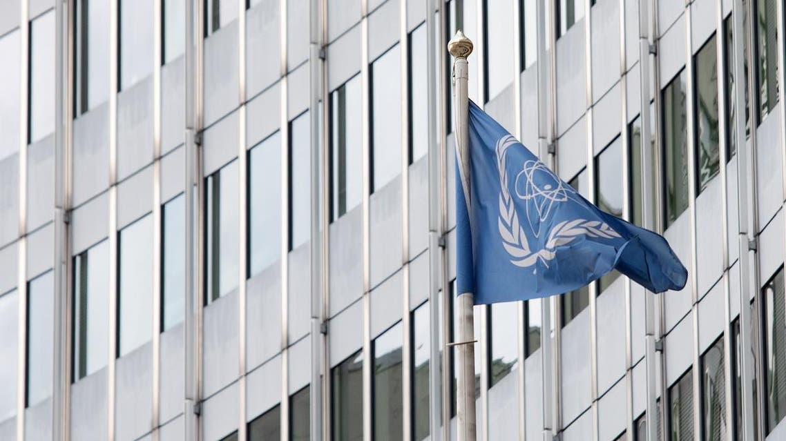The flag of the IAEA (International Atomic Energy Agency) waves in front of the IAEA building in Vienna on July 10, 2019. (AFP)