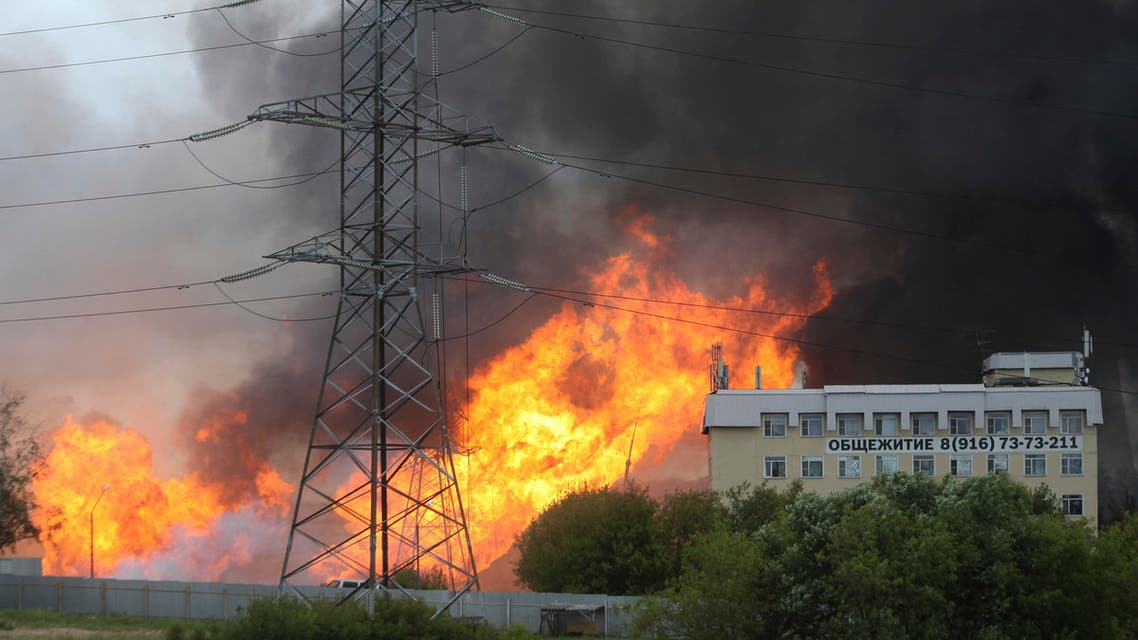 Black smoke and flames rise over a power station, in Mytishchi, outside Moscow, Russia, Thursday, July 11, 2019.  (AP)