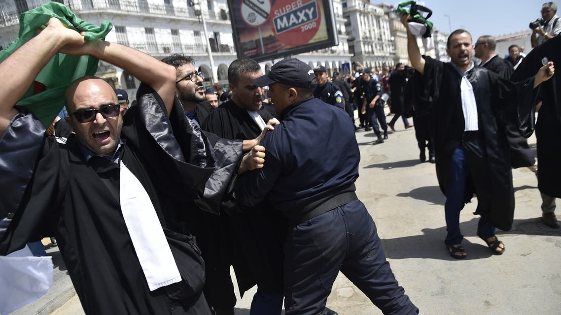 Lawyers rally for change in the streets of the Algerian capital Algiers on July 11 2019, in the latest in weeks of rallies against the ruling class amid an ongoing political crisis in the country. French and Arabic slogans on placards read: Liberty of Expression (R), Yes for the Independence of the judiciary (C) and Freedom (L). Algeria has been rocked by months of demonstrations, forcing longtime president Abdelaziz Bouteflika to step down in April. Protesters have continued to take to the streets, demanding that regime insiders leave office and independent institutions be established ahead of eventual elections.
