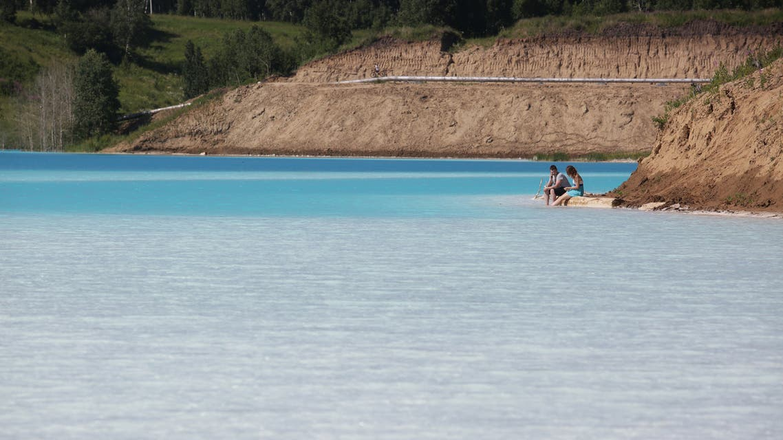 A view of a Novosibirsk energy plant's ash dump site - nicknamed the local Maldives - on July 11, 2019. An industrial dump site in Siberia whose turquoise lake resembles a tropical paradise has become a magnet for Instagrammers who risk their health in the toxic water to wow online followers.
