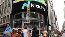 Nasdaq ends at record as Fed chief signals possible rate cut