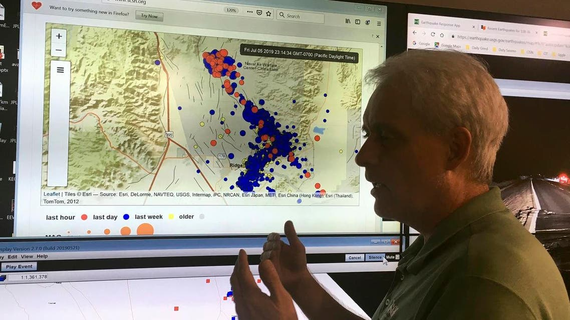 Robert Graves, a seismologist from the US Geological Survey, stands in front of a display of earthquakes in Searles Valley during a news conference  on July 5. (AP)
