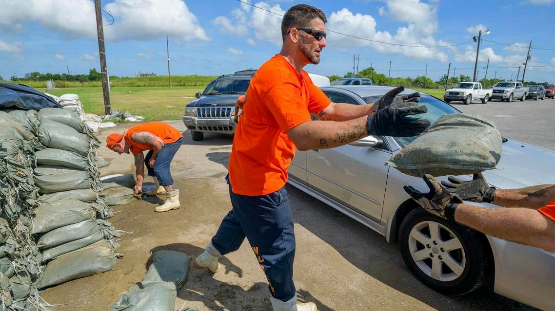 St. Bernard Parish Sheriff's Office inmate workers move free sandbags for residents in Chalmette, La., Thursday, July 11, 2019, ahead of ahead of Tropical Storm Barry from the Gulf of Mexico. (AP)