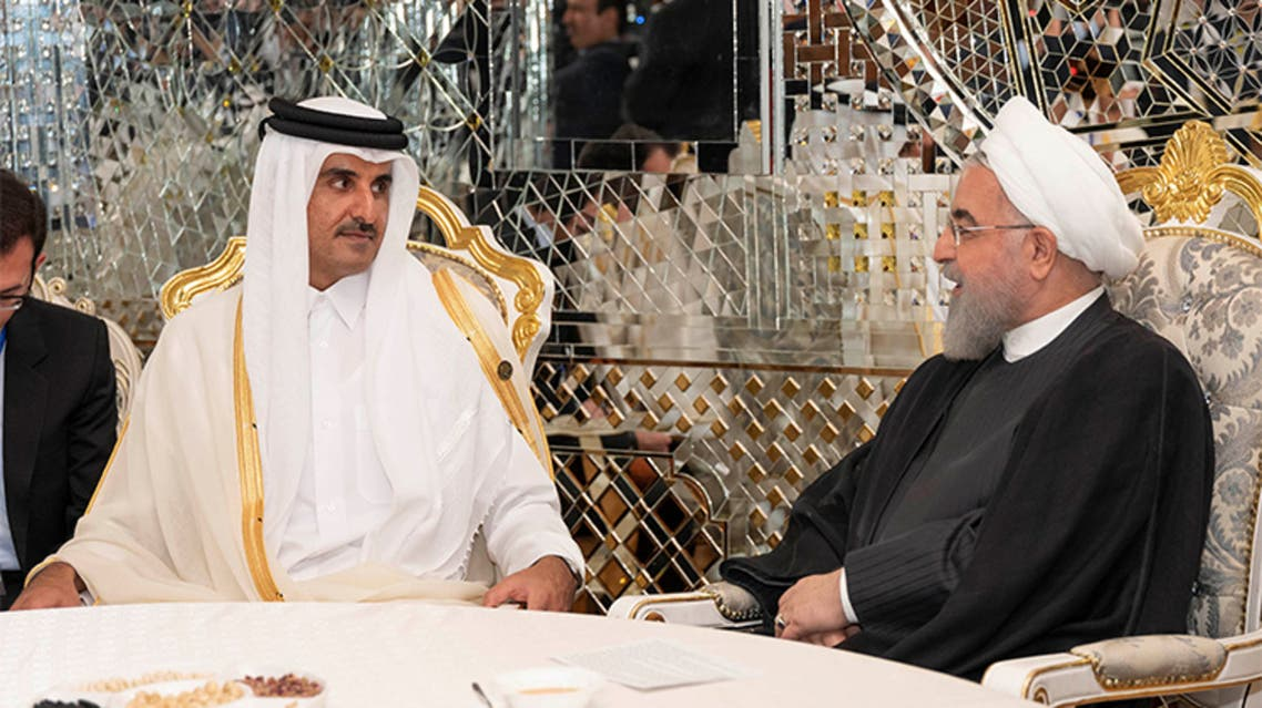 الرئيس الأغيراني حسن روحاني وأمير قطر الشيخ تميم