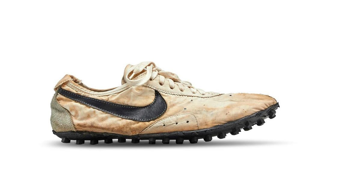 """The Nike """"Moon Shoe"""" one of only about 12 pairs of the handmade running shoe designed by Nike co-founder and legendary Oregon University track coach Bill Bowerman. (Reuters)"""