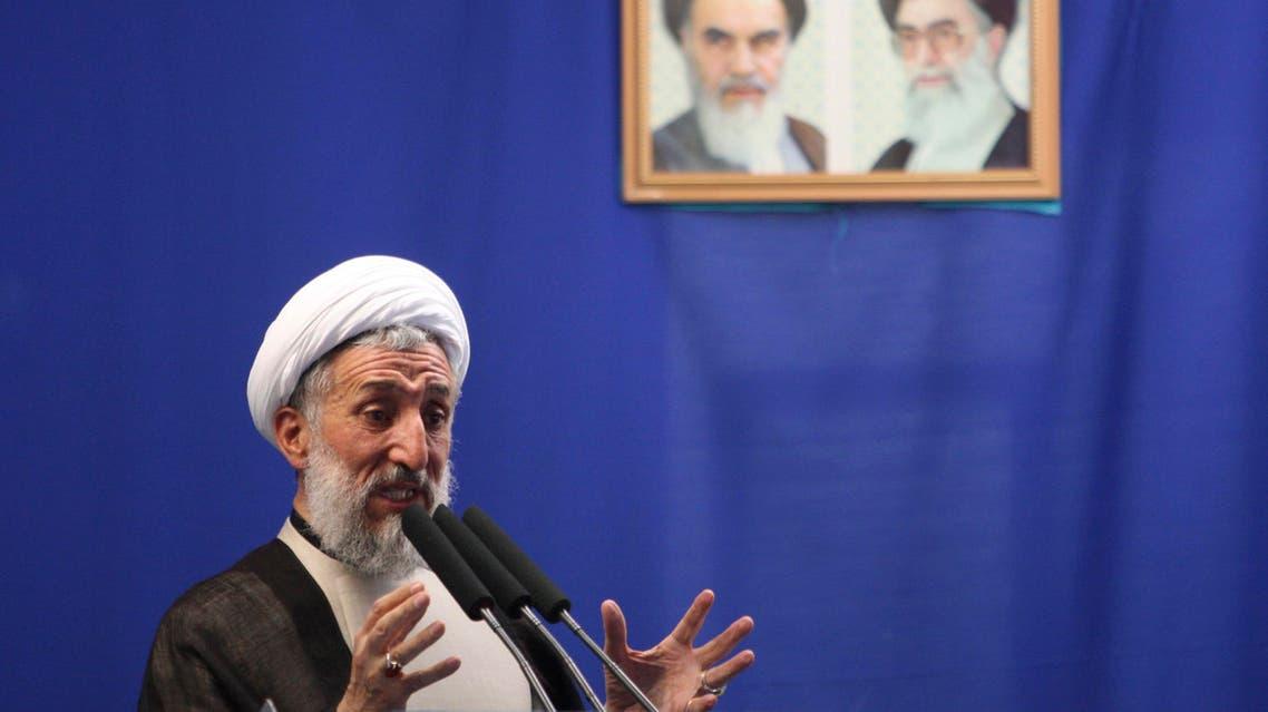 Senior Iranian cleric Hojatoleslam Kazem Sedighi, delivers a Friday prayer sermon, in front of portraits of the late revolutionary founder Ayatollah Khomeini, left, and supreme leader Ayatollah Ali Khamenei, at the Tehran University campus in Tehran, Iran, Friday, July 16, 2010. (AP)