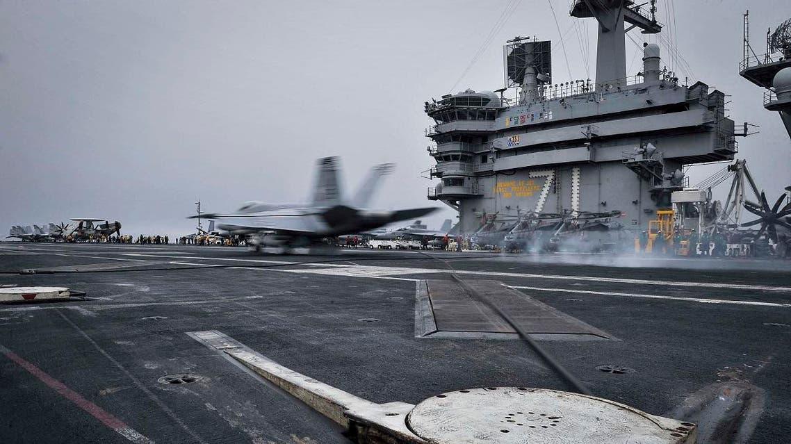 An F/A-18E Super Hornet lands on the flight deck aboard Nimitz-class aircraft carrier USS Theodore Roosevelt in the Fifth Fleet area of operations. (AP)