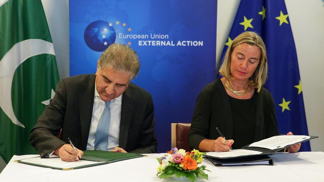 Pakistan's Foreign Affairs Minister Shah Mehmood Qureshi (left) along with European Commission's Federica Mogherini sign the EU-Pakistan Strategic Engagement Plan in Brussels, on June 25, 2019.  (AFP)
