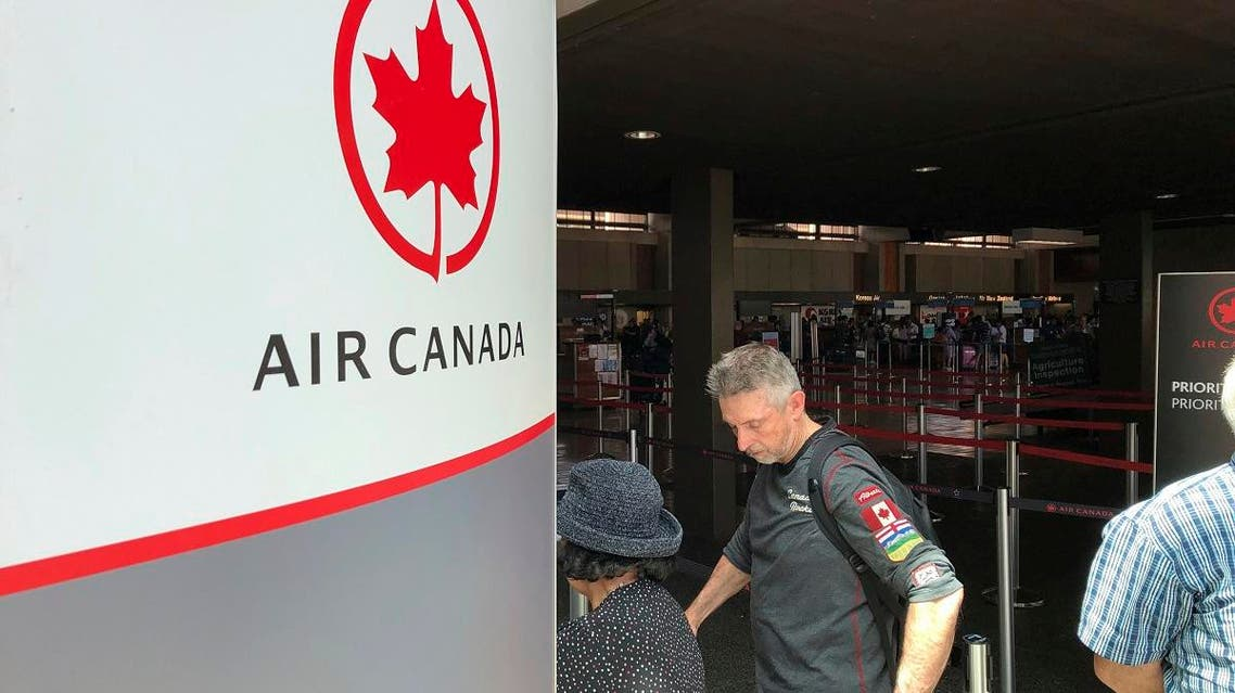 Passengers from an Australia-bound Air Canada flight diverted to Honolulu on July 11, 2019, after about 35 people were injured during turbulence, stand in line at the Air Canada counter at Daniel K. Inouye International Airport to rebook flights. (AP)