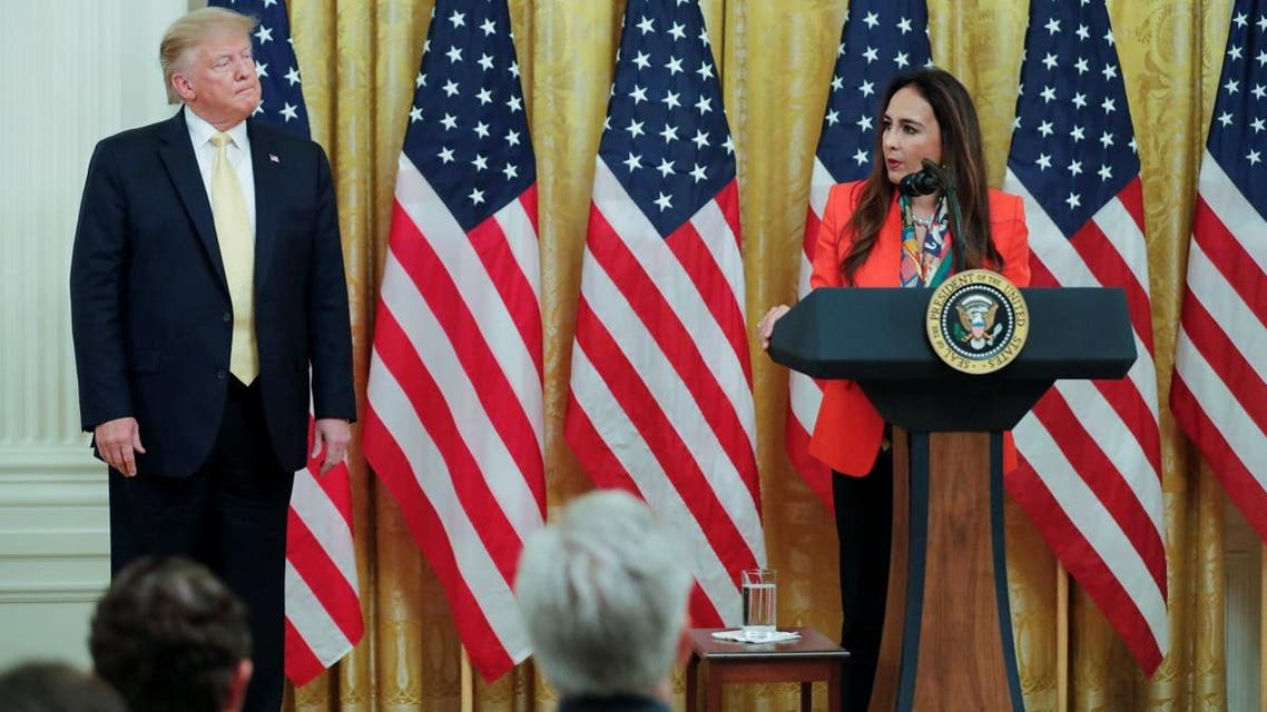 US President Donald Trump listens as attorney Harmeet Dhillon addresses his social media summit with prominent conservative social media figures in the East Room of the White House in Washington, on July 11, 2019. (Reuters)
