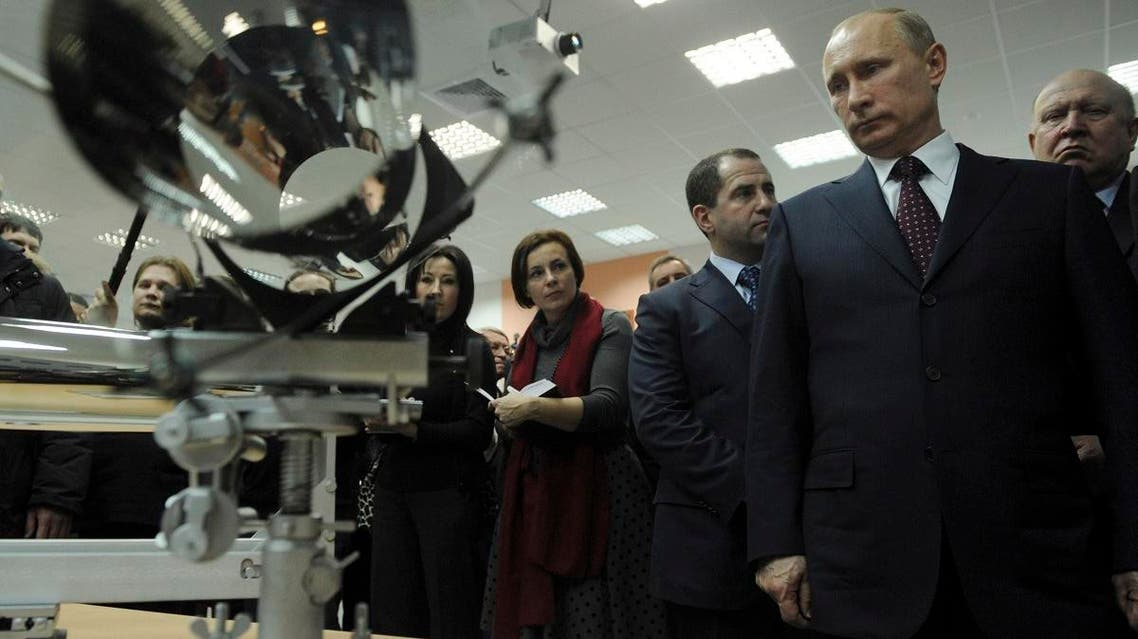 File photo of Vladimir Putin, (right front), looking at an X-ray mirror of space telescope during his visit to the Sarov nuclear center, former Arzamas-16, near Nizhny Novgorod, Russia. (AP)