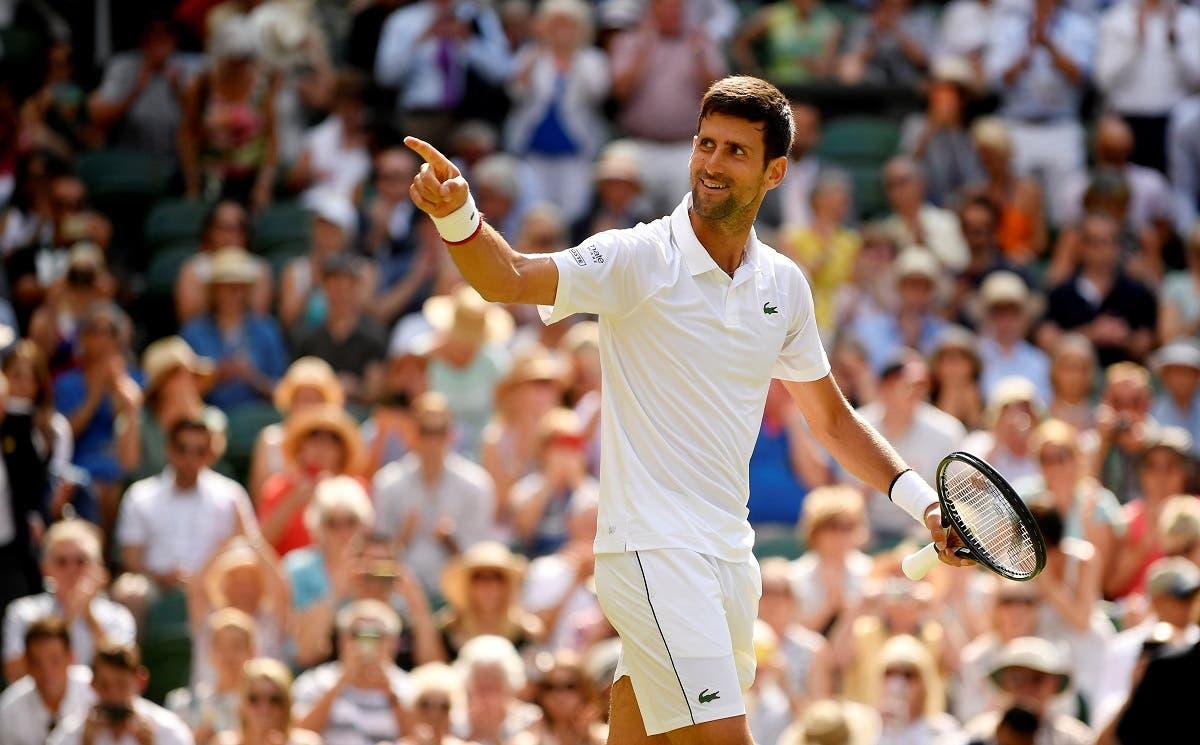 Novak Djokovic celebrates after winning his Wimbledon semi-final match against Roberto Bautista Agut on July 12, 2019. (Reuters)
