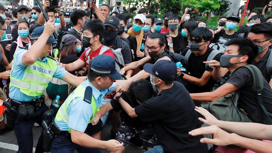 Police try to disperse pro-democracy activists after a march at Sheung Shui, a city border town in Hong Kong, on July 13, 2019. (Reuters)